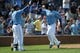 Sep 5, 2013; Kansas City, MO, USA; Kansas City Royals second baseman Emilio Bonifacio (64) is congratulated by designated hitter Billy Butler (16) after scoring in the fifth inning of the game against the Seattle Mariners at Kauffman Stadium. The Royals won 7-6. Mandatory Credit: Denny Medley-USA TODAY Sports