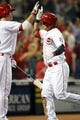 Sep 5, 2013; Cincinnati, OH, USA; Cincinnati Reds center fielder Shin-Soo Choo (17) is congratulated by first baseman Joey Votto (19) after hitting a home run during the fourth inning against the St. Louis Cardinals at Great American Ball Park. Mandatory Credit: Frank Victores-USA TODAY Sports