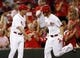 Sep 5, 2013; Cincinnati, OH, USA; Cincinnati Reds third baseman Todd Frazier (21) is congratulated by third base coach Mark Berry (41) after hitting a home run during the third inning against the St. Louis Cardinals at Great American Ball Park. Mandatory Credit: Frank Victores-USA TODAY Sports