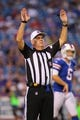 Aug 29, 2013; Orchard Park, NY, USA; NFL head linesman Julian Mapp (52) during a game between the Buffalo Bills and the Detroit Lions at Ralph Wilson Stadium.  Mandatory Credit: Timothy T. Ludwig-USA TODAY Sports