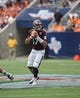 Aug 31, 2013; Houston, TX, USA; Mississippi State Bulldogs quarterback Tyler Russell (17) looks for an open receiver during the second quarter against the Oklahoma State Cowboys at Reliant Stadium. Mandatory Credit: Troy Taormina-USA TODAY Sports
