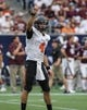 Aug 31, 2013; Houston, TX, USA; Oklahoma State Cowboys cornerback Justin Gilbert (4) signals before a play during the second quarter against the Mississippi State Bulldogs at Reliant Stadium. Mandatory Credit: Troy Taormina-USA TODAY Sports