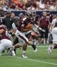 Aug 31, 2013; Houston, TX, USA; Mississippi State Bulldogs quarterback Dak Prescott (15) runs with the ball during the fourth quarter against the Oklahoma State Cowboys at Reliant Stadium. Mandatory Credit: Troy Taormina-USA TODAY Sports
