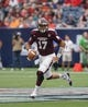 Aug 31, 2013; Houston, TX, USA; Mississippi State Bulldogs quarterback Tyler Russell (17) looks for an open receiver during the first quarter against the Oklahoma State Cowboys at Reliant Stadium. Mandatory Credit: Troy Taormina-USA TODAY Sports