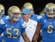 Aug 31, 2013; Pasadena, CA, USA; UCLA Bruins coach Jim Mora (center) during the game against the Nevada Wolf Pack at the Rose Bowl. UCLA defeated Nevada 58-20. Mandatory Credit: Kirby Lee-USA TODAY Sports