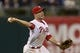 Sep 6, 2013; Philadelphia, PA, USA; Philadelphia Phillies third baseman Cody Asche (25) throws to first base during the ninth inning against the Atlanta Braves at Citizens Bank Park. The Phillies defeated the Braves 2-1. Mandatory Credit: Howard Smith-USA TODAY Sports