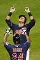 Sep 6, 2013; Cleveland, OH, USA; Cleveland Indians first baseman Nick Swisher (back) celebrates his grand slam home run in the eighth inning against the New York Mets at Progressive Field. Mandatory Credit: David Richard-USA TODAY Sports
