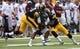 Sep 7, 2013; Iowa City, IA, USA; University of Iowa linebacker Christian Kirksey (20 ) and cornerback Desmond King (14) tackle Missouri State Bears wide receiver Julian Burton (3) during the first quarter at Kinnick Stadium.  Mandatory Credit: Reese Strickland-USA TODAY Sports