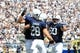 Sep 7, 2013; University Park, PA, USA; Penn State Nittany Lions running back Zach Zwinak (28) celebrates with teammates Jesse James (18) and Ty Howle (60) after scoring a touchdown during the third quarter against the Eastern Michigan Eagles at Beaver Stadium. Penn State defeated Eastern Michigan 45-7. Mandatory Credit: Matthew O'Haren-USA TODAY Sports