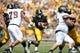 Sep 7, 2013; Iowa City, IA, USA; Iowa Hawkeyes running back Damon Bullock (5) carries the football against the Missouri State Bears at Kinnick Stadium.  Iowa beat Missouri State 28-14.  Mandatory Credit: Reese Strickland-USA TODAY Sports