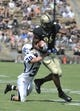 Sep 7, 2013; West Lafayette, IN, USA;  Purdue Boilermakers tight end Gabe Holmes (86) runs after a catch with Indiana State Sycamores defensive back Tsali Lough (30) hanging on in the 2nd half at Ross Ade Stadium. Mandatory Credit: Sandra Dukes-USA TODAY Sports