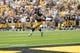 Sep 7, 2013; Iowa City, IA, USA; Iowa Hawkeyes quarterback Jake Rudock (15) rolls out to pass against the Missouri State Bears at Kinnick Stadium.  Iowa beat Missouri State 28-14.  Mandatory Credit: Reese Strickland-USA TODAY Sports