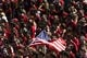 Sep 7, 2013; Philadelphia, PA, USA; Temple Owls fans hold up an American flag during the playing of the national anthem prior to playing the Houston Cougars at Lincoln Financial Field. Houston defeated temple 22-13. Mandatory Credit: Howard Smith-USA TODAY Sports