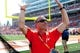 Sep 7, 2013; Champaign, IL, USA; Illinois Fighting Illini athletic director Mike Thomas gestures to the student body during the fourth quarter against the Cincinnati Bearcats at Memorial Stadium. Illinois won 45-17.  Mandatory Credit: Bradley Leeb-USA TODAY Sports