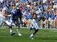 Sep 7, 2013; Memphis, TN, USA;Duke Blue Devils quarterback Anthony Boone (7) rushes for a touch down against Memphis Tigers at Liberty Bowl Memorial. Mandatory Credit: Justin Ford-USA TODAY Sports