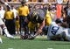 Sep 7, 2013; Columbia, MO, USA;  Missouri Tigers offensive linesman Evan Boehm (77) recovers a fumble against the Toledo Rockets during the first half at Faurot Field. Mandatory Credit: Jasen Vinlove-USA TODAY Sports