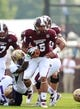 Sep 7, 2013; Starkville, MS, USA; Mississippi State Bulldogs quarterback Dak Prescott (15) is grabbed from behind by Alcorn State Braves defensive back DJ MOrgan (20) at Davis Wade Stadium. Mandatory Credit: Marvin Gentry-USA TODAY Sports