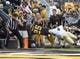 Sep 7, 2013; Laramie, WY, USA; Wyoming Cowboys tight end Spencer Bruce (25) scores a touchdown against Idaho Vandals cornerback Jayshawn Jordan (4) during the second quarter at War Memorial Stadium. Mandatory Credit: Troy Babbitt-USA TODAY Sports