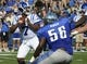 Sep 7, 2013; Memphis, TN, USA;Duke Blue Devils quarterback Anthony Boone (7) is pressured by Memphis Tigers defensive lineman Terry Redden (56) at Liberty Bowl Memorial. Mandatory Credit: Justin Ford-USA TODAY Sports