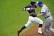 Sep 7, 2013; Cleveland, OH, USA; Cleveland Indians second baseman Jason Kipnis (left) reaches first base safely as New York Mets first baseman Lucas Duda (21) is pulled off the bag by an errant throw in the first inning at Progressive Field. Mandatory Credit: David Richard-USA TODAY Sports
