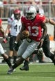 Sep 7, 2013; Columbus, OH, USA; Ohio State Buckeyes quarterback Kenny Guiton (13) carries the ball against the San Diego State Aztecs at Ohio Stadium. Ohio State won the game 42-7. Mandatory Credit: Greg Bartram-USA TODAY Sports