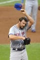 Sep 7, 2013; Cleveland, OH, USA; New York Mets starting pitcher Jonathon Niese (49) reacts after giving up a double with the bases loaded in the first inning against the Cleveland Indians at Progressive Field. Mandatory Credit: David Richard-USA TODAY Sports