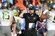 Sep 7, 2013; Charlottesville, VA, USA; Oregon Ducks head coach Mark Helfrich (center) reacts in the second half. The Ducks defeated the Virginia Cavaliers 59-10 at Scott Stadium. Mandatory Credit: Bob Donnan-USA TODAY Sports