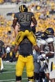 Sep 7, 2013; Columbia, MO, USA;  Missouri Tigers running back Henry Josey (20) is congratulated by a teammate after scoring a touchdown during the second half against the Toledo Rockets. Missouri defeats Toledo 38-23 at Faurot Field . Mandatory Credit: Jasen Vinlove-USA TODAY Sports