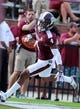 Sep 7, 2013; Starkville, MS, USA;  Mississippi State Bulldogs wide receiver Jameon Lewis (4) scores against the Alcorn State Braves at Davis Wade Stadium.  The Bulldogs defeated the Braves 51-7. Mandatory Credit: Marvin Gentry-USA TODAY Sports