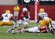 Sep 7, 2013; Lincoln, NE, USA; Nebraska Cornhuskers running back Ameer Abdullah (8) runs against Southern Mississippi Golden Eagles defenders Kelsey Douglas (6) and Ed Wilkins (20) in the second quarter at Memorial Stadium. Mandatory Credit: Bruce Thorson-USA TODAY Sports