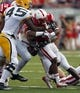 Sep 7, 2013; Lincoln, NE, USA; Nebraska Cornhuskers running back Ameer Abdullah (8) is tackled by Southern Mississippi Golden Eagles defender Dasman McCullum (45) in the second quarter at Memorial Stadium. Mandatory Credit: Bruce Thorson-USA TODAY Sports