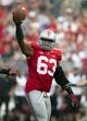 Sep 7, 2013; Columbus, OH, USA; Ohio State Buckeyes defensive lineman Michael Bennett (63) celebrates after recovering a fumble against the San Diego State Aztecs at Ohio Stadium. Ohio State won the game 42-7. Mandatory Credit: Greg Bartram-USA TODAY Sports