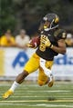 Sep 7, 2013; Laramie, WY, USA; Wyoming Cowboys wide receiver Robert Herron (6) runs against the Idaho Vandals during the third quarter at War Memorial Stadium. The Cowboys defeated the Vandals 42-10. Mandatory Credit: Troy Babbitt-USA TODAY Sports