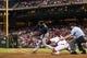 Sep 7, 2013; Philadelphia, PA, USA; Atlanta Braves first baseman Freddie Freeman (5) hits a two RBI single during the third inning against the Philadelphia Phillies at Citizens Bank Park. Mandatory Credit: Howard Smith-USA TODAY Sports