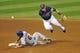 Sep 7, 2013; Cleveland, OH, USA; Cleveland Indians shortstop Asdrubal Cabrera (13) turns a double play over New York Mets center fielder Matt den Dekker (6) in the fifth inning at Progressive Field. Mandatory Credit: David Richard-USA TODAY Sports