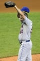 Sep 7, 2013; Cleveland, OH, USA; New York Mets relief pitcher Scott Atchison (50) reacts after giving up a three-run home run in the seventh inning against the Cleveland Indians at Progressive Field. Mandatory Credit: David Richard-USA TODAY Sports