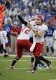 Sep 7, 2013; Lawrence, KS, USA; South Dakota Coyotes quarterback Josh Vander Maten (7) throws a pass against the Kansas Jayhawks in the first half at Memorial Stadium. Mandatory Credit: John Rieger-USA TODAY Sports