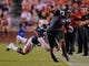 Sep 7, 2013; Auburn, AL, USA; Arkansas State Red Wolves wide receiver Julian Jones (7) eludes the defense of Auburn Tigers cornerback Chris Davis (11) at Jordan Hare Stadium. Mandatory Credit: Shanna Lockwood-USA TODAY Sports