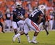 Sep 7, 2013; Auburn, AL, USA; Auburn Tigers quarterback Nick Marshall (14) hands the ball off to Auburn Tigers running back Cameron Artis-Payne (44) in the game against the Arkansas State Red Wolves at Jordan Hare Stadium. Mandatory Credit: Shanna Lockwood-USA TODAY Sports