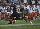 Sep 7, 2013; Evanston, IL, USA; Northwestern Wildcats quarterback Kain Colter (2) is tackled by Syracuse Orange linebacker Cameron Lynch (38) during the third quarter at Ryan Field. Mandatory Credit: David Banks-USA TODAY Sports