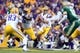 Sep 7, 2013; Baton Rouge, LA, USA; LSU Tigers quarterback Zach Mettenberger (8) looks to pass the ball against the UAB Blazers during the first quarter at Tiger Stadium. Mandatory Credit: Crystal LoGiudice-USA TODAY Sports