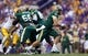 Sep 7, 2013; Baton Rouge, LA, USA; UAB Blazers quarterback Austin Brown (11) runs with the ball against the LSU Tigers during the first quarter at Tiger Stadium. Mandatory Credit: Crystal LoGiudice-USA TODAY Sports