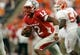 Sep 7, 2013; El Paso, TX, USA; New Mexico Lobos quarterback Clayton Mitchem (12) scrambles against the UTEP Miners defense during the first half at Sun Bowl Stadium. Mandatory Credit: Ivan Pierre Aguirre-USA TODAY Sports