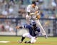 Sep 7, 2013; San Diego, CA, USA; Colorado Rockies shortstop Troy Tulowitzki (2) jumps over San Diego Padres shortstop Ronny Cedeno (3) after a force out at second base during the fourth inning at Petco Park. Mandatory Credit: Christopher Hanewinckel-USA TODAY Sports