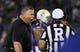 Sep 7, 2013; Lawrence, KS, USA; Kansas Jayhawks head coach Charlie Weis (left) talks to referee Reggie Smith (right) about a call in the second half of the game with the South Dakota Coyotes at Memorial Stadium. Kansas won the game 31-14. Mandatory Credit: John Rieger-USA TODAY Sports