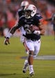 Sep 7, 2013; Auburn, AL, USA; Auburn Tigers running back Tre Mason (21) runs the ball against the Arkansas State Red Wolves at Jordan Hare Stadium. Mandatory Credit: Shanna Lockwood-USA TODAY Sports