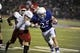 Sep 7, 2013; Lawrence, KS, USA; Kansas Jayhawks running back Brandon Bourbon (25) scores a touchdown against South Dakota Coyotes linebacker Tyler Starr (11) in the second half at Memorial Stadium. Kansas won the game 31-14. Mandatory Credit: John Rieger-USA TODAY Sports