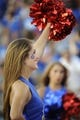 Sep 7, 2013; Lawrence, KS, USA; A Kansas Jayhawks cheerleader performs against the South Dakota Coyotes in the first half at Memorial Stadium. Kansas won the game 31-14. Mandatory Credit: John Rieger-USA TODAY Sports