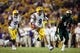 Sep 7, 2013; Baton Rouge, LA, USA; LSU Tigers quarterback Zach Mettenberger (8) carries the ball against the UAB Blazers in the second half at Tiger Stadium. LSU defeated UAB 56-17. Mandatory Credit: Crystal LoGiudice-USA TODAY Sports