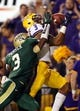 Sep 7, 2013; Baton Rouge, LA, USA; LSU Tigers wide receiver Odell Beckham (3) catches a pass in front of UAB Blazers cornerback Lamarcus Farmer (3) for a touchdown in the second half at Tiger Stadium. LSU defeated UAB 56-17. Mandatory Credit: Crystal LoGiudice-USA TODAY Sports